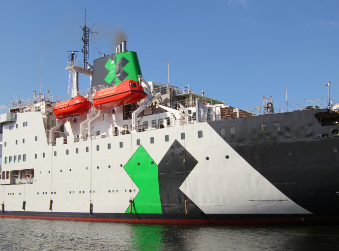 Specialists oversee major refit of ship set to become floating racing hub